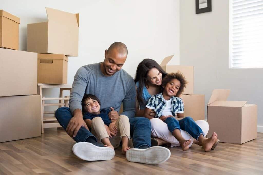 Buyers sitting on floor of home